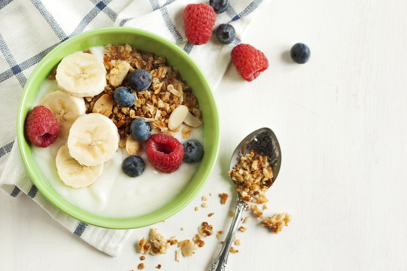 Homemade granola with yogurt and berry